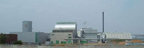 Une centrale CHP sur l'île de Masnedø, au Danemark. La chaleur générée est utilisée dans des serres adjacentes.