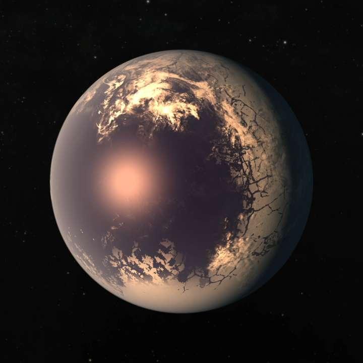 Vue d'artiste d'une planète froide et verrouillée en rotation synchrone autour de son étoile hôte. La glace recouvre une grande partie de la surface de la planète, mais le point directement face à l'étoile hôte de la planète reste libre de glace. © Nasa JPL-Caltech
