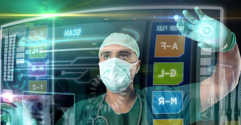 Médecin travaillant sur des écrans virtuels. © Luis Louro, Shutterstock