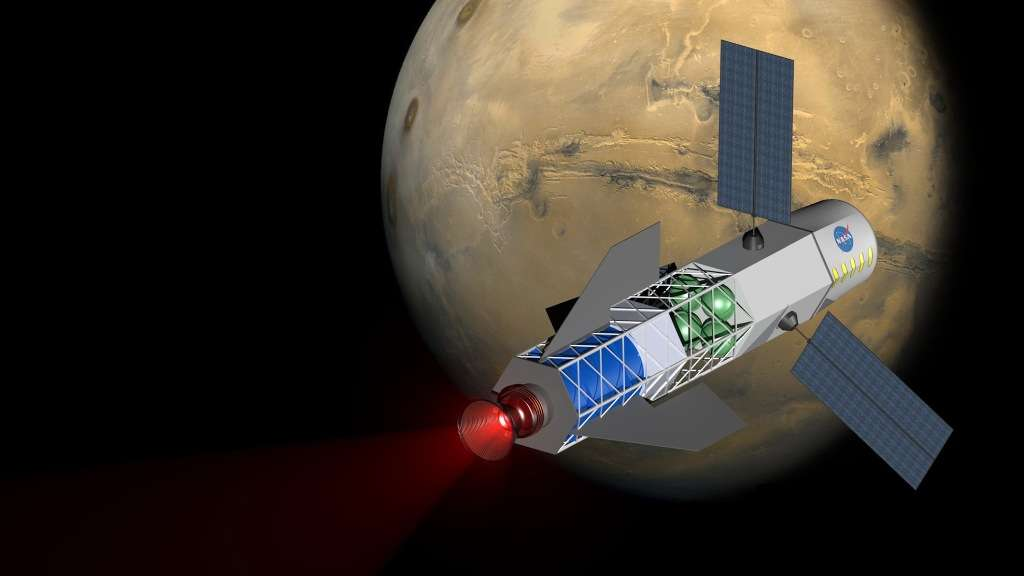 Une vue d'artiste d'un éventuel vaisseau équipé d'un moteur à fusion inertielle. Ses panneaux solaires serviraient à alimenter son moteur au cours d'un voyage de trois mois vers Mars. © Université de Washington, MSNW