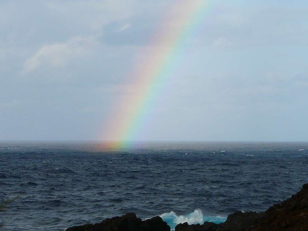 Photo d'un arc-en-ciel sur la mer