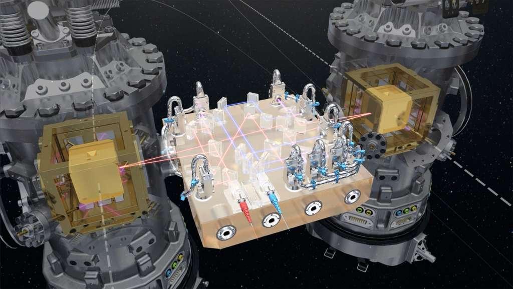 Au cœur du satellite Lisa Pathfinder se trouve le système de laser qui permettra de mesurer les infimes mouvements des deux masses étalons, baptisées Jake et Elwood, représentées ici par les cubes jaunes. © Esa, ATG Medialab
