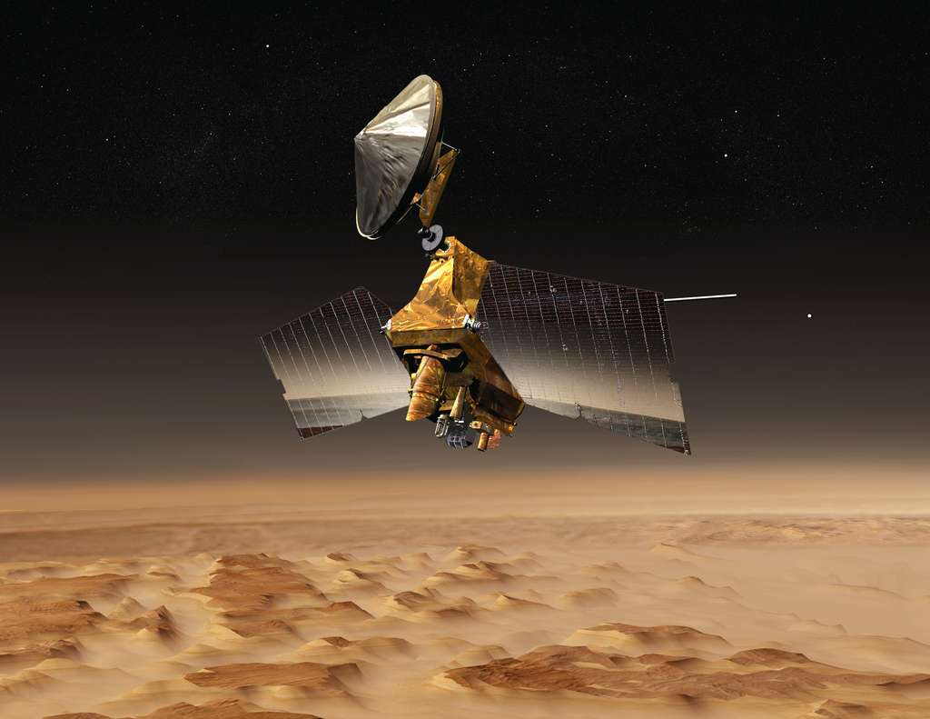 Vue d'artiste du Mars Reconnaissance Orbiter au-dessus de la planète Mars. © Nasa