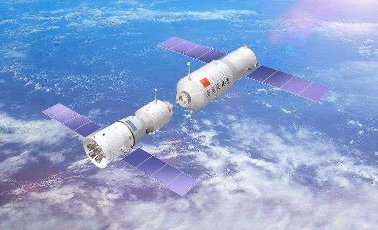 Vue d'artiste de l'amarrage d'un vaisseau Shenzhou (à gauche) avec le module orbital Tiangong-1, en orbite depuis septembre 2011. Son successeur, Tiangong-2, devrait prendre le relais en 2015 et accueillera peut-être un jour un engin venu d'un autre pays que la Chine. © CNSA