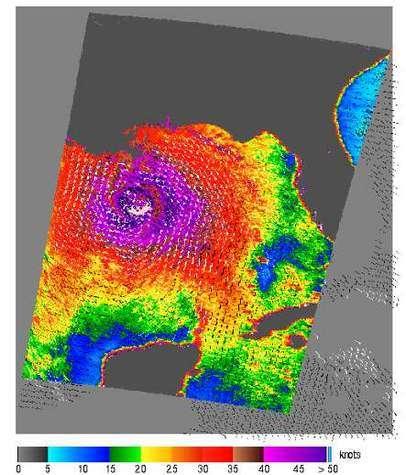 Vitesses et directions des vents de Katrina le 29 août 2005 (alors ouragan de catégorie 4), mesurées par le satellite QuikSCAT Les rafales les plus violentes figurent en violet, et entourent le centre de l'ouragan (Crédits : NASA JPL)