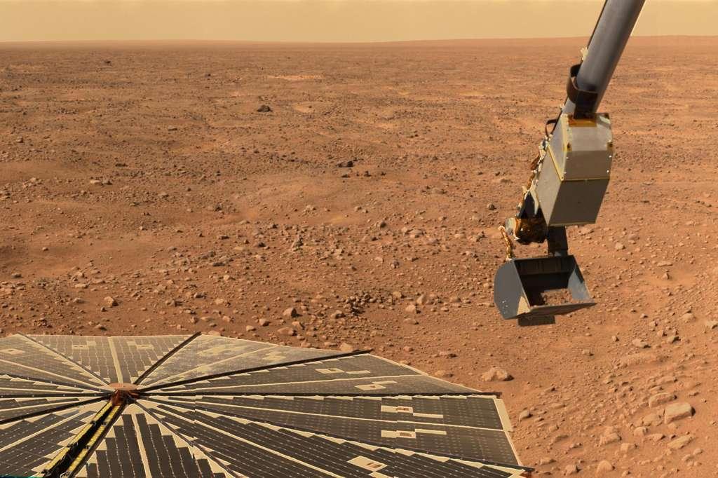 Le bras robotisé de Phoenix Mars Lander en action sur Mars. © Nasa