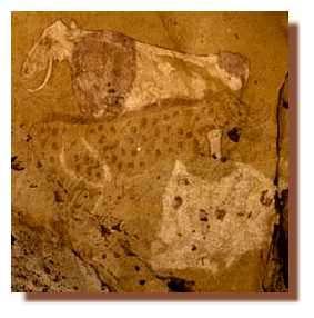 Bovidés à cornes en lyre ou pendantes. La robe d'une bête est rendu par des pointillé, une autre est couchée, une patte repliée contre le ventre.Tisseteka (Tadrart).