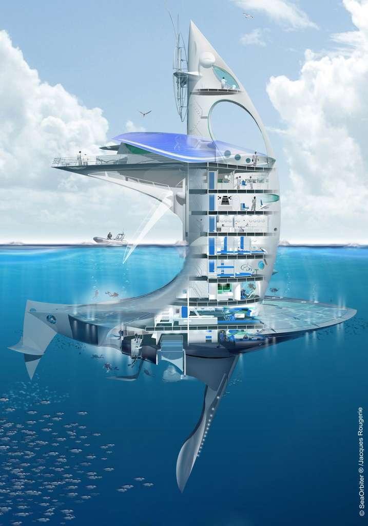 L'engin mesure 58 m de hauteur, avec 27 m au-dessus de l'eau et 31 m sous la surface. Les laboratoires et les installations de mise à l'eau des instruments se trouvent au-dessus. Les lieux de vie et la zone technique sont sous la surface. Les ponts les plus bas abritent des zones pressurisées, permettant aux plongeurs un accès permanent à l'extérieur, à 12 m de profondeur, de jour comme de nuit. C'est là aussi que se trouvent les plateformes de lancement des appareils sous-marins. La quille, relevable, pèse 180 tonnes. Tout en haut, une éolienne et des panneaux solaires assurent une partie de l'alimentation électrique. © Sea Orbiter