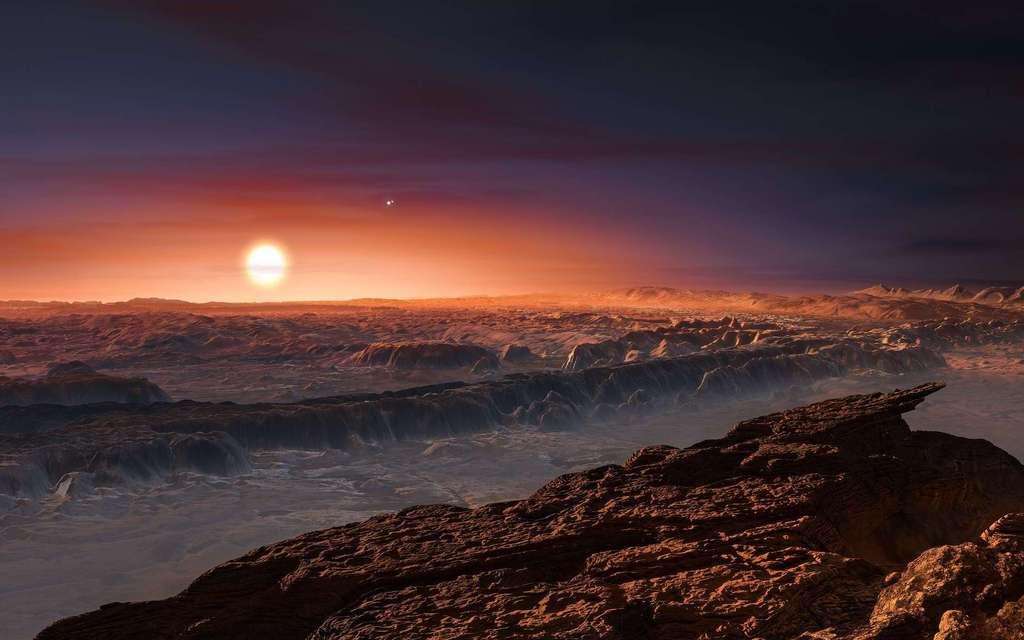 Cette représentation d'artiste montre une vue de la surface de la planète Proxima b en orbite autour de la naine rouge Proxima du Centaure, l'étoile la plus proche du Système solaire. Le système d'étoiles doubles Alpha Centauri AB figure dans l'angle supérieur droit de l'image. Proxima b est dotée d'une masse légèrement supérieure à celle de la Terre et décrit une orbite autour de Proxima Centauri, au sein même de la zone d'habitabilité de cette étoile, de sorte que sa température de surface est compatible avec la présence d'eau liquide. © M. Kornmesser, ESO
