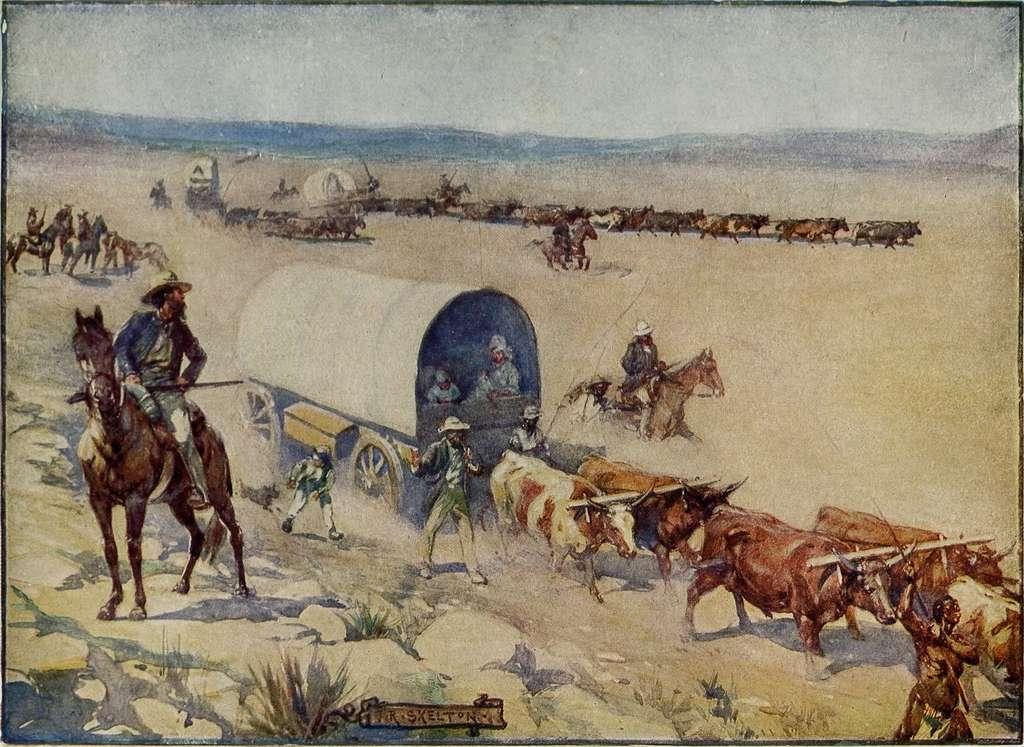 """Illustration du Grand Trek qui débute en 1835 : tableau """"The Voortrekkers"""" par J.R. Skelton vers 1909. © Wikimedia Commons, domaine public."""