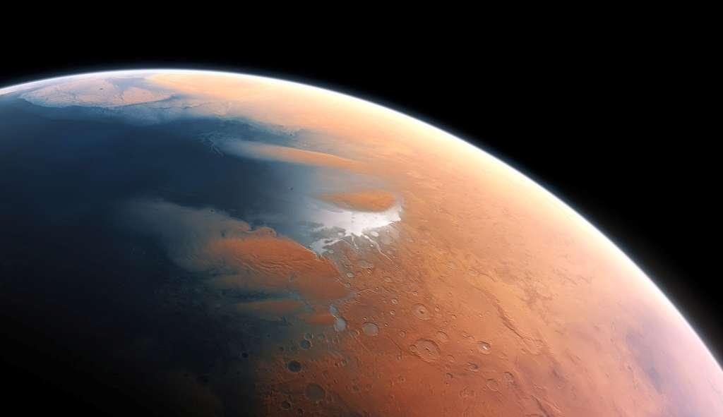 Cette vue d'artiste montre ce à quoi devait ressembler Mars voici quatre milliards d'années. La toute jeune planète devait renfermer suffisamment d'eau liquide pour que l'intégralité de sa surface en soit couverte, sur une hauteur d'environ 140 mètres. Il semble plus probable toutefois que l'eau liquide se soit constituée en un océan occupant près de la moitié de l'hémisphère nord de la planète. En certaines régions, la profondeur de cet océan pouvait dépasser 1,6 kilomètre. © ESO/M. Kornmesser
