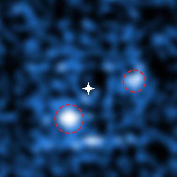 La grande luminosité de l'étoile PDS 70 a été éliminée de cette image de Muse sur le VLT après traitement des données. Les astronomes ont ainsi pu distinguer les deux jeunes planètes géantes qui sont en train de découper le disque protoplanétaire. © ESO, S. Haffert (Leiden Observatory)