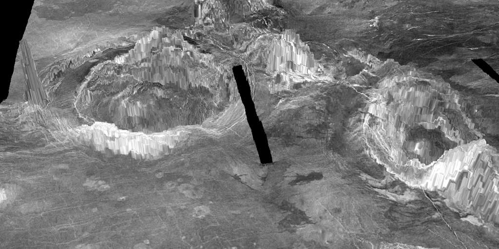 Le rendu 3D ci-dessus montre deux coronaes observées à la surface de Vénus. Les structures en forme d'anneau se forment lorsque des matériaux chauds du plus profond de la planète montent à travers le manteau et éclatent à travers la croûte. Une recherche menée par Laurent Montesi de l'UMD a révélé qu'au moins 37 coronae sur Vénus représentent une activité géologique récente, y compris celle nommée Aramaiti, vue à gauche sur cette image. La ligne noire représente une lacune dans les données. © University of Maryland, Laurent Montési