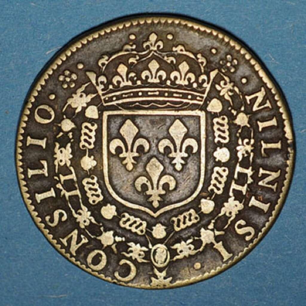 Monnaie-jeton de Conseil du roi Louis XIII, de 1633. Ces jetons sont distribués en étrennes au souverain et à ses proches, ils constituent une manière de glorifier le pouvoir du roi ; « Nil nisi Consilio » : « rien sans le Conseil ». Poinsignon numismatique. © Poinsignon 2013