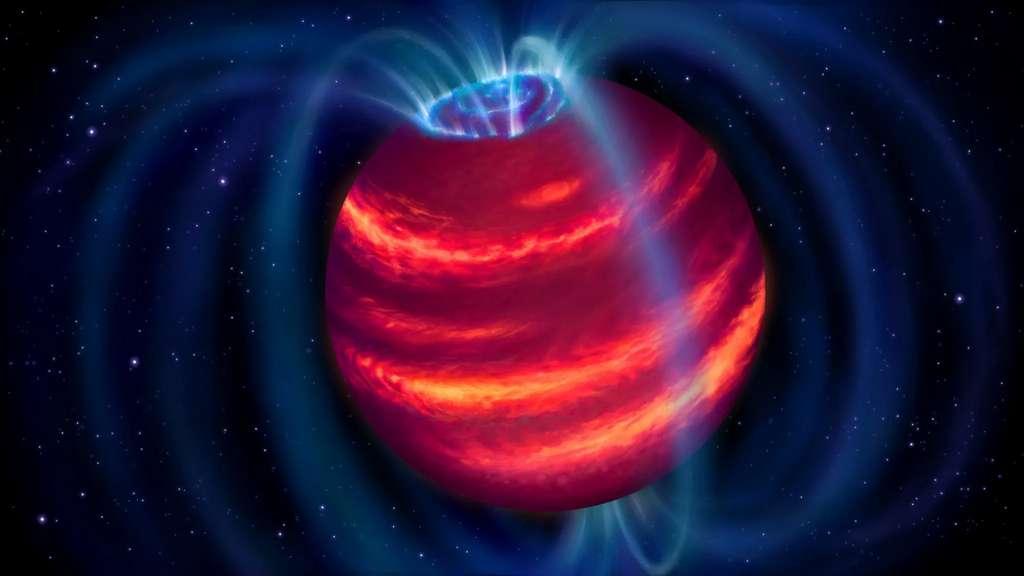 Vue d'artiste de BDR J1750+3809, alias Elegast. Les boucles bleues représentent les lignes de champ magnétique. Les particules chargées se déplaçant le long de ces lignes émettent des ondes radio que Lofar a détectées. Certaines particules finissent par atteindre les pôles et produisent alors des aurores polaires, telles que l'on peut aussi en observer sur Terre. © Danielle Futselaar, Astron