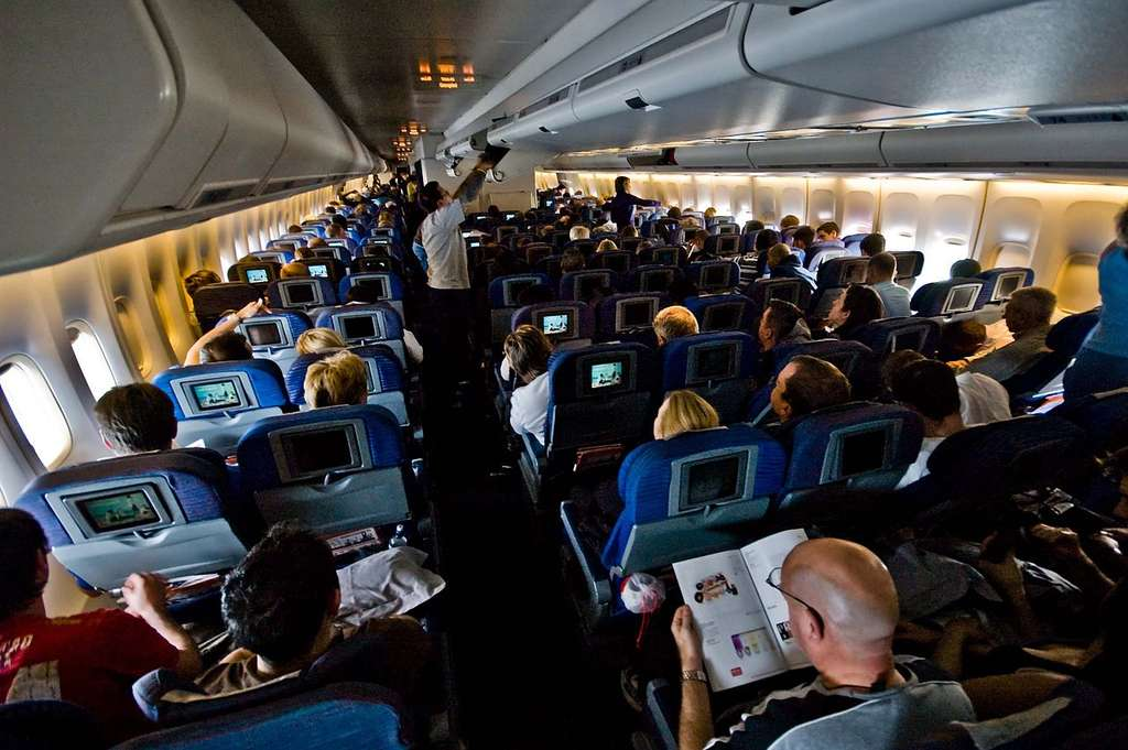 Ces passagers à bord d'un avion n'ont pas l'air d'avoir peur. Mais combien gardent pour eux leurs appréhensions liées au vol ? © René Ehrhardt, CC by-nc 2.0