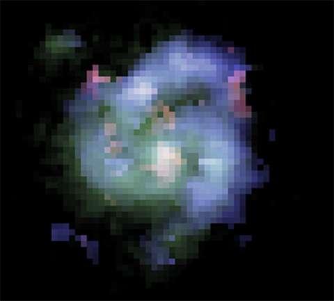 Il est représenté ici une vraie image de la grande galaxie spirale BX442 telle qu'elle était il y a 10,7 milliards d'années. Elle a été composée à partir d'observations faites par Hubble et le télescope Keck à Hawaï. © David Law, Dunlap Institute for Astronomy & Astrophysics