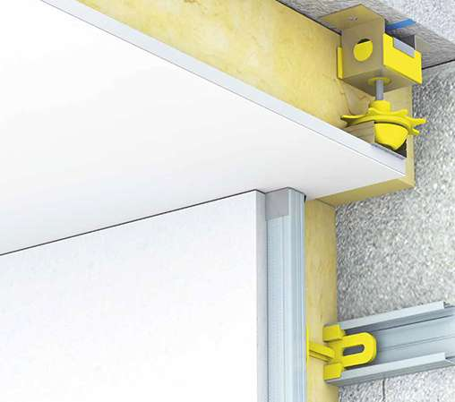 L'isolation phonique d'une pièce repose sur l'effet masse-ressort-masse des matériaux. Pour éviter la propagation des bruits, la structure d'un doublage phonique doit être désolidarisée pour éliminer la présence de ponts phoniques. Dans le cas d'un faux plafond, il est conseillé d'utiliser des suspentes qui ne transmettent pas les vibrations (antivibratiles). © Isover