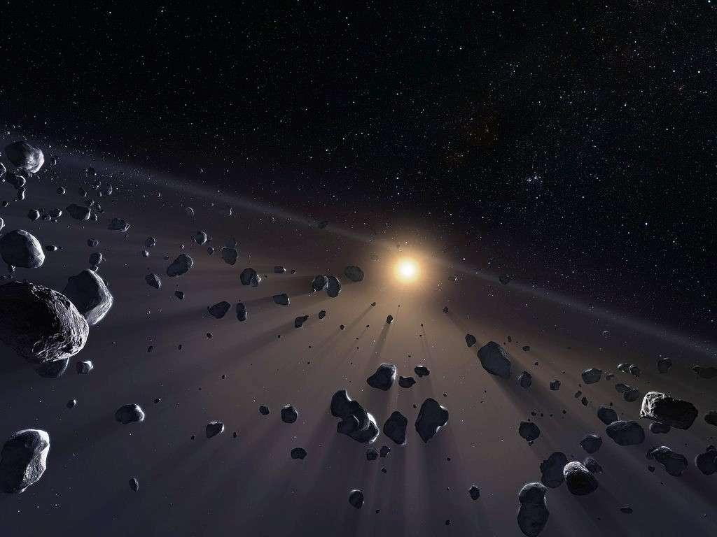 Une vue d'artiste de la ceinture de Kuiper. Les distances entre les TNO sont considérablement plus grandes dans la réalité. © ESO/M. Kornmesser