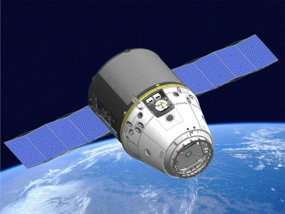 Vue d'artiste de la capsule Dragon, avec ses panneaux solaires déployés, conçue pour ravitailler l'ISS. © SpaceX