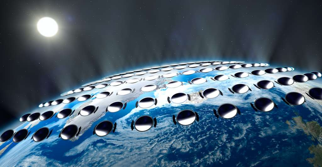 Cette illustration symbolise l'idée qui se cache derrière l'injection de particules dans notre atmosphère : former un bataillon de minuscules miroirs qui empêcheraient une partie du rayonnement que la Terre reçoit du Soleil d'arriver jusqu'au sol. © visdia, Adobe Stock