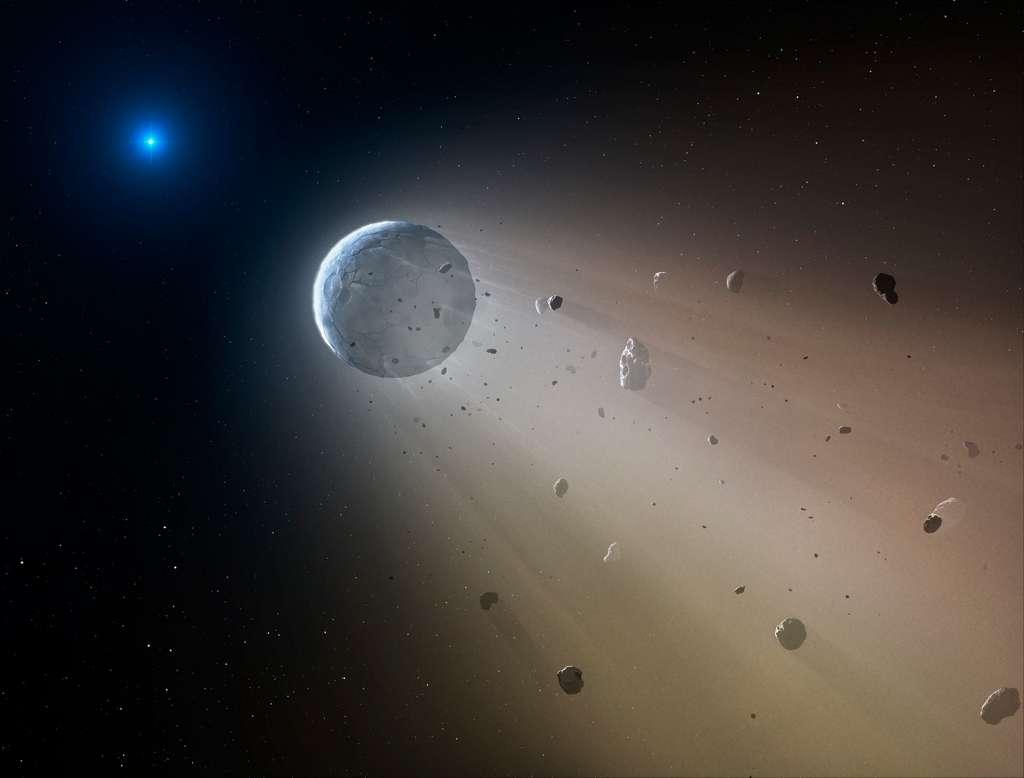 lllustration de la déchéance d'une planète autour de la naine blanche WD 1145+017. Les observations de Kepler en 2015 ont permis de détecter qu'un anneau de débris entoure l'étoile compacte. Un objet aussi gros qu'un astéroïde occulte jusqu'à 40 % de la lumière de l'étoile compacte toutes les 4,5 heures et s'accompagne d'une traînée de poussières. © CfA, Mark A. Garlick