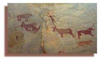 Un berger armé d'une lance et d'un bâton tente d'éloigner l'animal sauvage qui vient de tuer une vache de son troupeau. Wadi Aramat