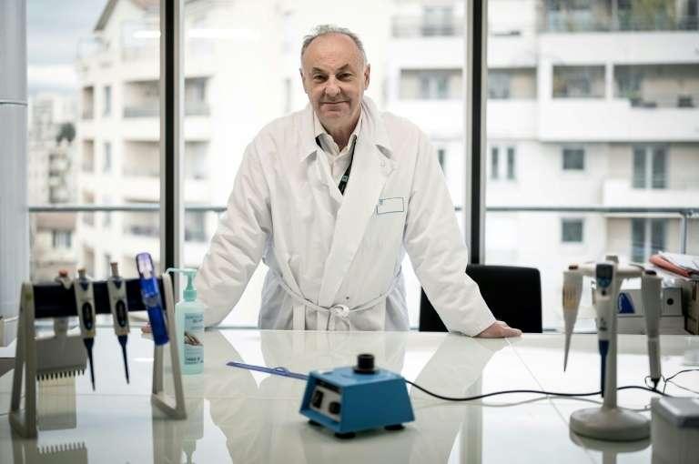 Le professeur Bruno Lina au laboratoire de l'hôpital de la Croix-Rousse, à Lyon, le 14 janvier 2021. © Jeff Pachoud, AFP