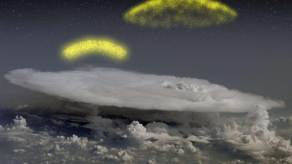 Des flashs d'électrons et de positrons, montant vers le haut de l'atmosphère, ici représentés en jaune sont produits par des processus d'accélération dans certains nuages. © Nasa/Goddard Space Flight Center.