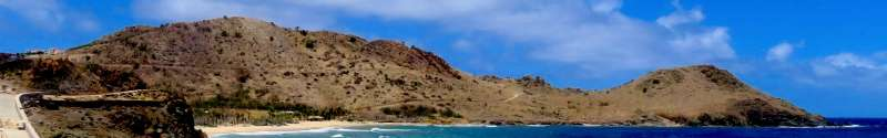 Vue du chevauchement de la pointe Toiny. Cet affleurement clé a permis de dater une phase compressive régionale, responsable d'une émersion, qui a permis des migrations entre les Grandes Antilles et le nord des Petites Antilles. © Mélody Philippon