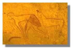 Le rituel du guerrier et du mouton. Cette scène avec un homme au corps penché associé à un mouton et une arme se retrouve souvent. Il pourrait s'agir d'un jeu ou d'un rituel guerrier