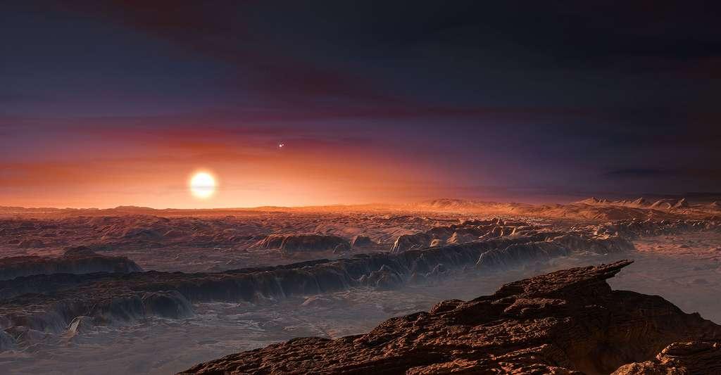 Cette représentation d'artiste montre une vue de la surface de la planète Proxima b en orbite autour de la naine rouge Proxima du Centaure, l'étoile la plus proche du Système Solaire. © ESO/M. Kornmesser CC BY 4.0