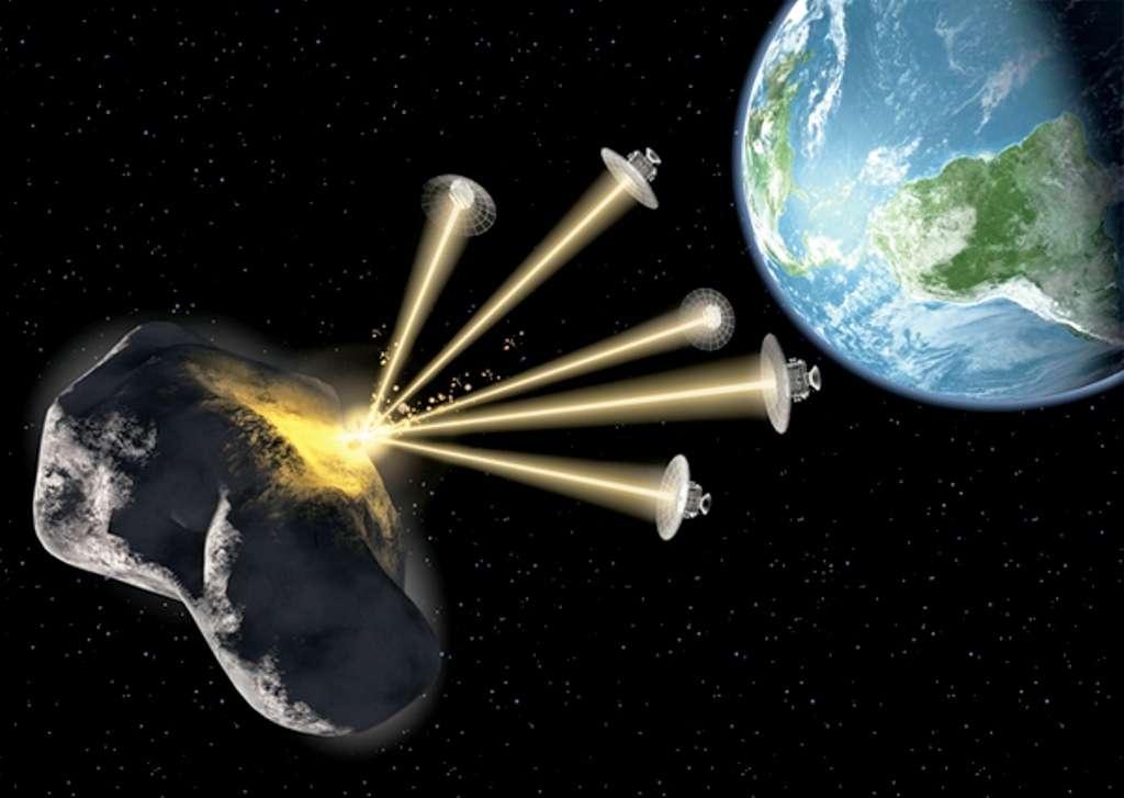 Une vue d'artiste de l'essaim de satellites équipés de laser proposé pour dévier un astéroïde. © The Planetary Society