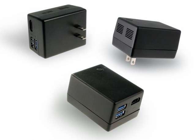 Le Compute Plug de Quanta : cet ordinateur se cache dans un boîtier d'alimentation. Il se connecte à un écran, par exemple un téléviseur par le port HDMI. Ce petit appareil dispose aussi d'une interface Bluetooth et de deux prises USB 3.0. © Quanta