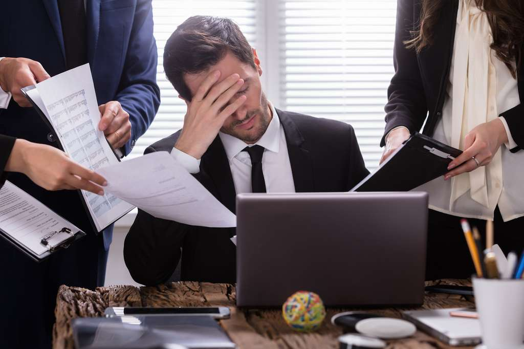 Au travail, un excès de stress peut conduire au burn-out. © Andrey Popov, Fotolia