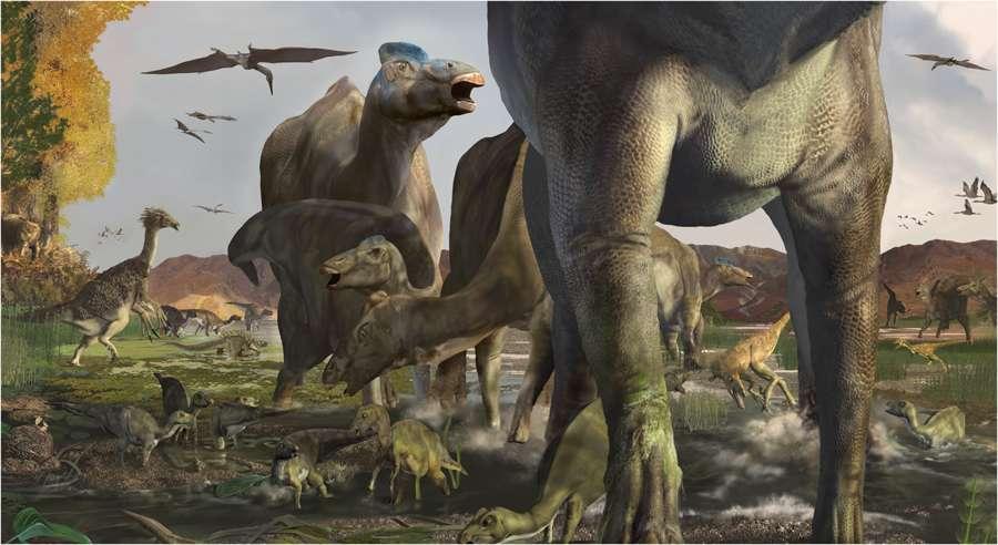 Un troupeau de dinosaures à bec de canard, au premier plan, se promène, voisinant des thérizinosaures, comme celui visible à l'arrière-plan à gauche. © Karen Carr, Nature