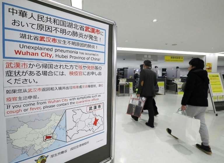 À l'aéroport de Tokyo-Narita. © STR/JIJI Press, AFP