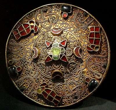 Fibules bronze or argent grenat et verre, VIIème s. ap. JC.