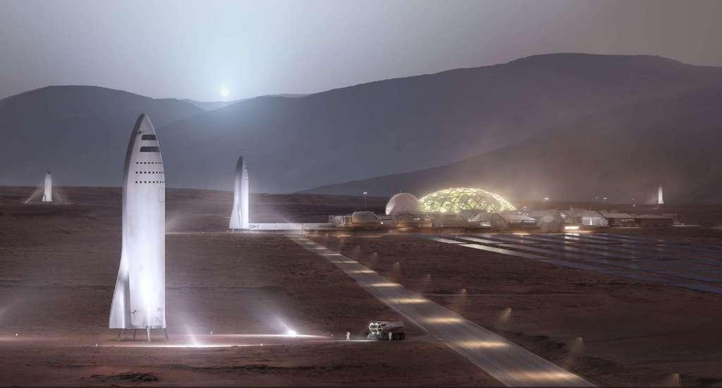 Voici à quoi pourrait ressembler la colonisation de Mars par SpaceX, avec la base au loin, et à gauche les énormes fusées BFR, renommées depuis peu Starship. © SpaceX