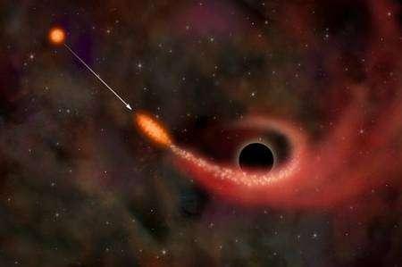 Figure 1. Une étoile passant près d'un trou noir prend une forme de cigare avant d'être mise en pièces. Une partie de la matière chaude tombe dans le trou noir, l'autre est éjectée au loin. © Nasa/CXC/M Weiss