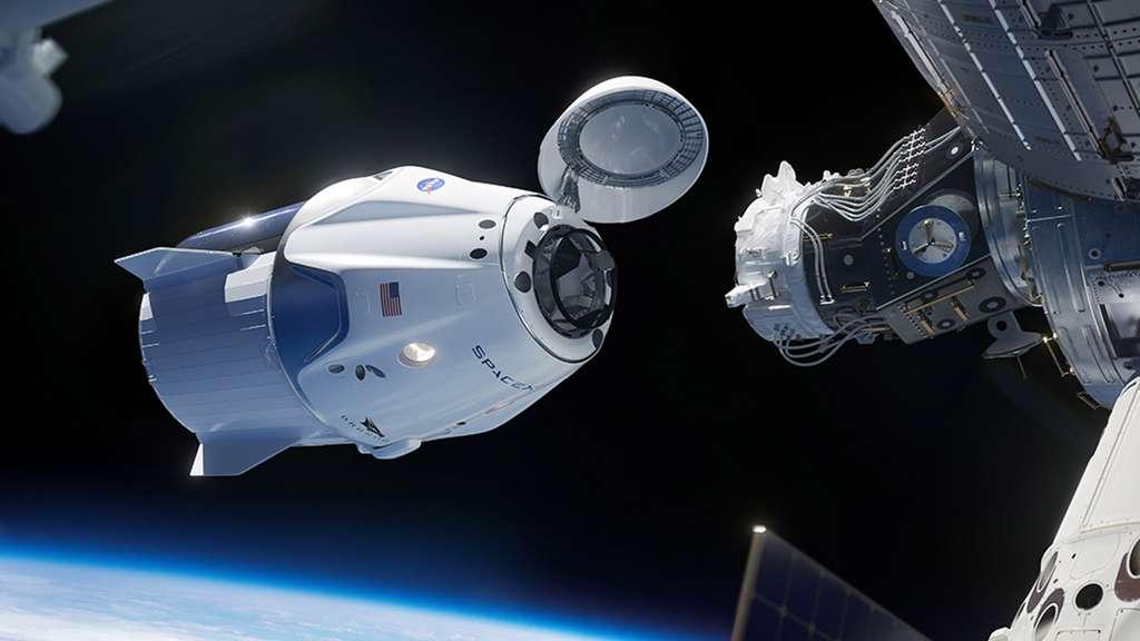 Vue d'artiste du vaisseau spatial Crew Dragon amarré à la Station spatiale internationale. © SpaceX