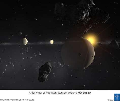 Vue d'artiste du système planétaire découvert par le chasseur de planètes HARPS (Crédits : ESO)