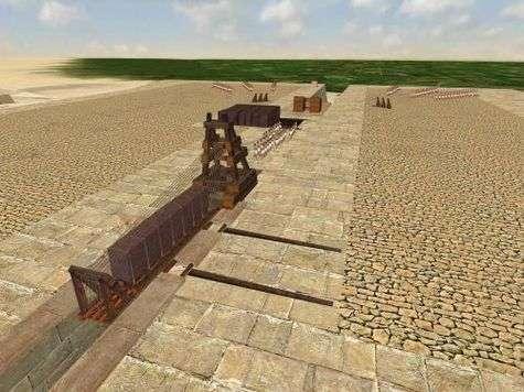 Le contrepoids descendant dans la grande galerie, à l'opposé de la rampe d'accès, aide à hisser ce bloc de granit de plus de 60 tonnes sur le niveau 43 mètres de la pyramide en chantier. Crédit : Dassault Systèmes
