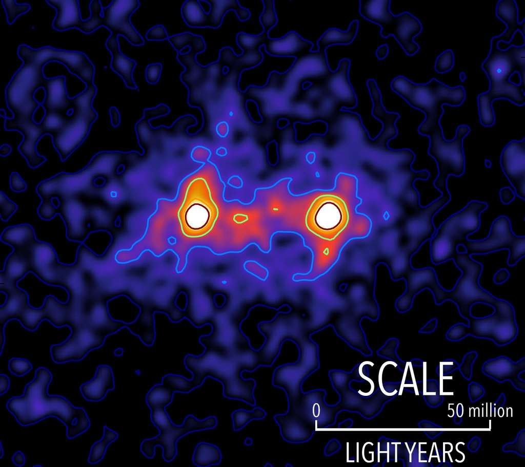 Cette image en fausse couleurs a été obtenue en étudiant l'effet de lentille gravitationnelle faible produit par un très grand nombre de paires de galaxies situées à environ 4,5 milliards d'années-lumière de la Voie lactée. Les taches blanches représentent deux galaxies. © S. Epps & M. Hudson, University of Waterloo