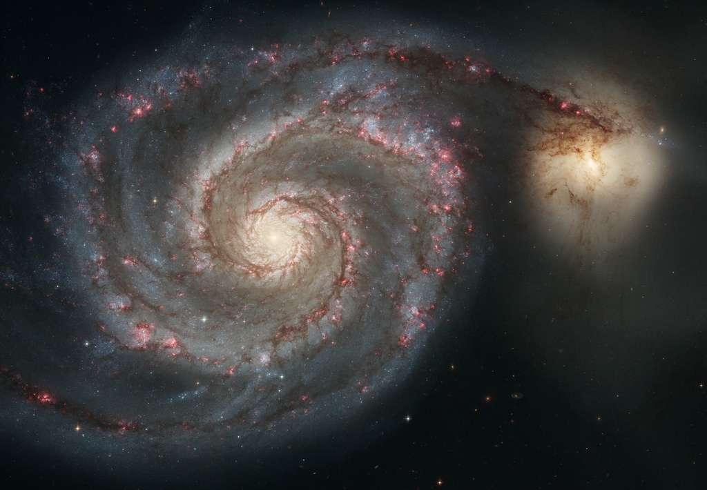Cette photographie spectaculaire prise avec le télescope Hubble, en 2005, montre M51, aussi connue comme la galaxie du Tourbillon (Whirlpool Galaxy en anglais), un couple de galaxies à environ 27,4 millions d'années-lumière dans la constellation des Chiens de chasse. La galaxie spirale régulière a un diamètre estimé à 100.000 années-lumière, comme la Voie lactée, donnant une idée de ce qui se passera avec notre Galaxie quand elle entrera en collision avec une petite galaxie irrégulière, le Grand Nuage de Magellan.© Nasa