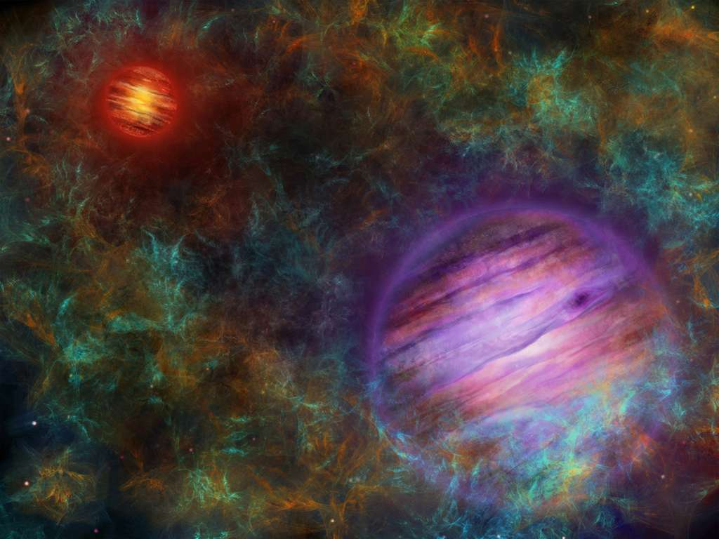 Vue d'artiste d'Oph 98, avec Oph 98 B en violet à l'avant-plan et Oph 98 A en rouge en arrière-plan. Oph 98 A est le membre le plus massif et en conséquence le plus lumineux et chaud de la paire. Les deux objets sont entourés du nuage moléculaire dans lequel ils se sont formés. © Université de Berne, Thibaut Roger.