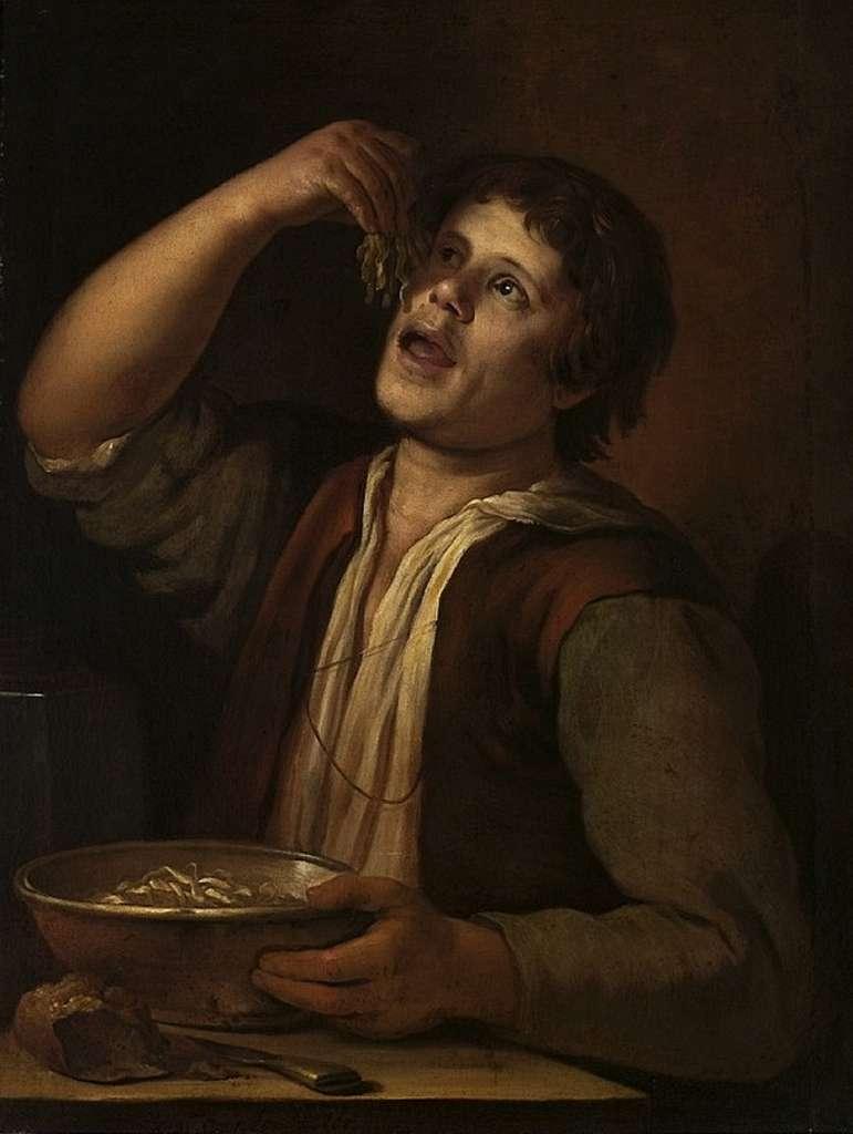 """Tableau """"Le mangeur de pâtes"""" par Jan Vermeer van Utrecht, en 1656. Musée National de Varsovie, Pologne. © Wikimedia Commons, domaine public."""