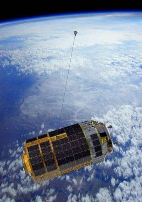 Vue artistique du dispositif Kite, qui s'apparente à une ancre spatiale, testé sur le cargo nippon HTV-6 de retour d'une mission de ravitaillement de l'ISS. © Jaxa