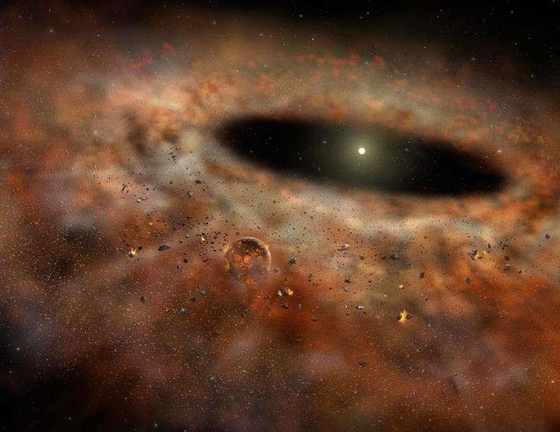 Une vue d'artiste du disque de poussière autour de TYC 8241 2652. Une planète (hypothétique) y est visible encore en formation, bombardée par des petits corps célestes qui eux-mêmes entrent en collision. C'est un disque de débris. © Gemini Observatory-Lynette Cook