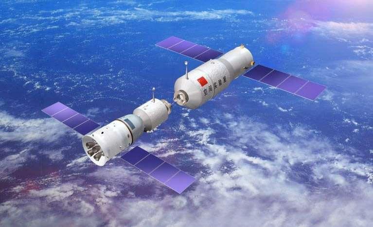 L'équipage de Shenzhou-9 doit réaliser le premier amarrage spatial habité de la Chine avec Tiangong-1 (à droite). © DR